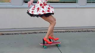 Kckflip to One Foot in high heels on a mini-cruiser
