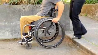 Curbs and Steps: SCI Empowerment Project Wheelchair Skills Video 11