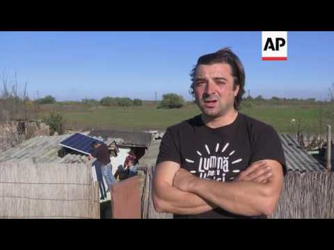Volunteers turn on the light in remote Romanian villages