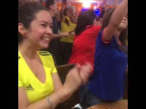 Noches of Colombia patrons erupted in cheers as Colombia beat Senegal 1-0, advancing to the next round of the World Cup Thursday.