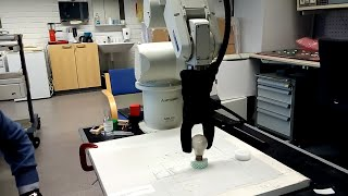 Adaptive Robotic 2 Finger Gripper. Grasping of light bulb