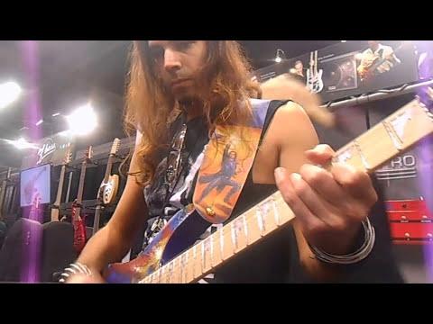 Ethan Brosh playing his custom Jeff Leigh Guitar at NAMM