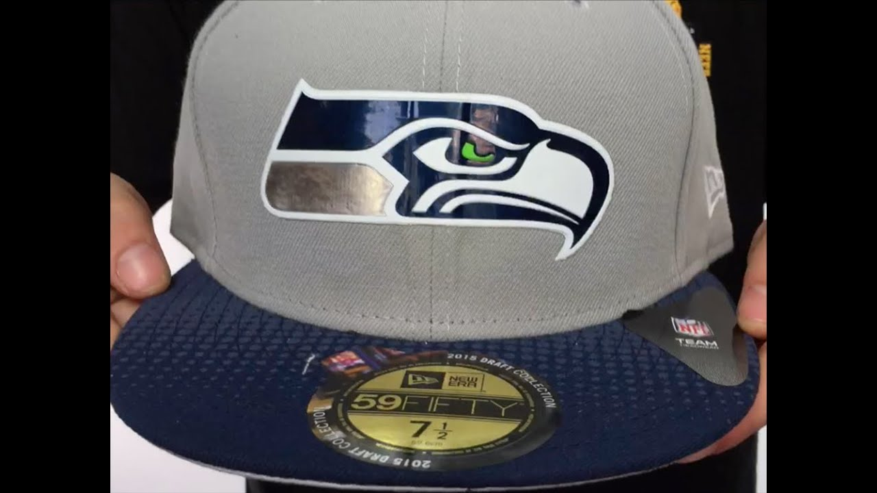 Seahawks  2015 NFL DRAFT  Grey-Navy Fitted Hat by New Era - YouTube 3ff50fc0f13