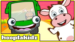 Repeat youtube video Wheels On The Bus | Nursery Rhymes For Children | Green Bus | HD Version 2 from HooplaKidz