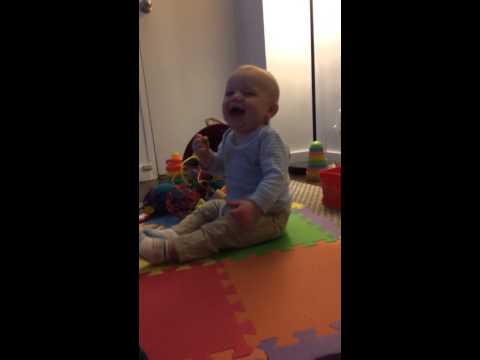 Baby finds sneezing hilarious