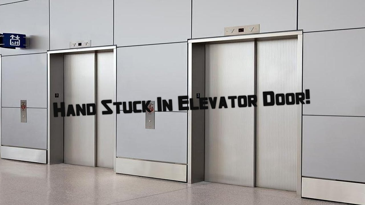 how to open a stuck elevator door