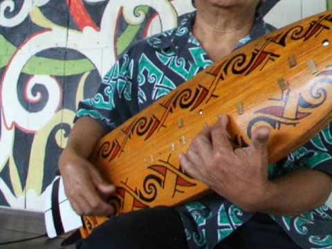 sarawak cultural village orang ulu playing sape