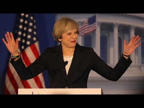 May: International institutions need to be reformed