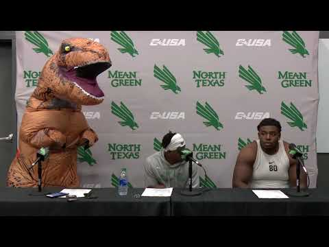 Dan's Football Page - QUARTERBACK ADDRESSES PRESS WHILE WEARING A DINOSAUR COSTUME
