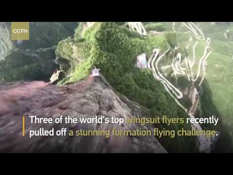 #MostWatched World-class wingsuit flyers complete formation flying in central #China
