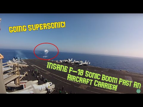 Going Supersonic - F-18 Sonic Boom Past A US Navy Aircraft Carrier