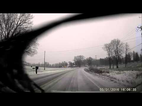 Idiot cammer loses control while testing road conditions.