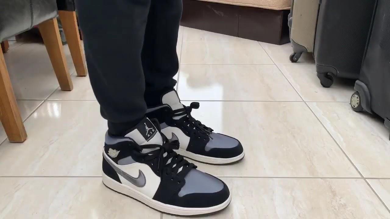 grey air jordan 1 mid on feet