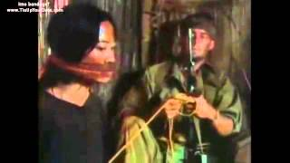 Asian woman bound and gagged by American soldier (film scene)