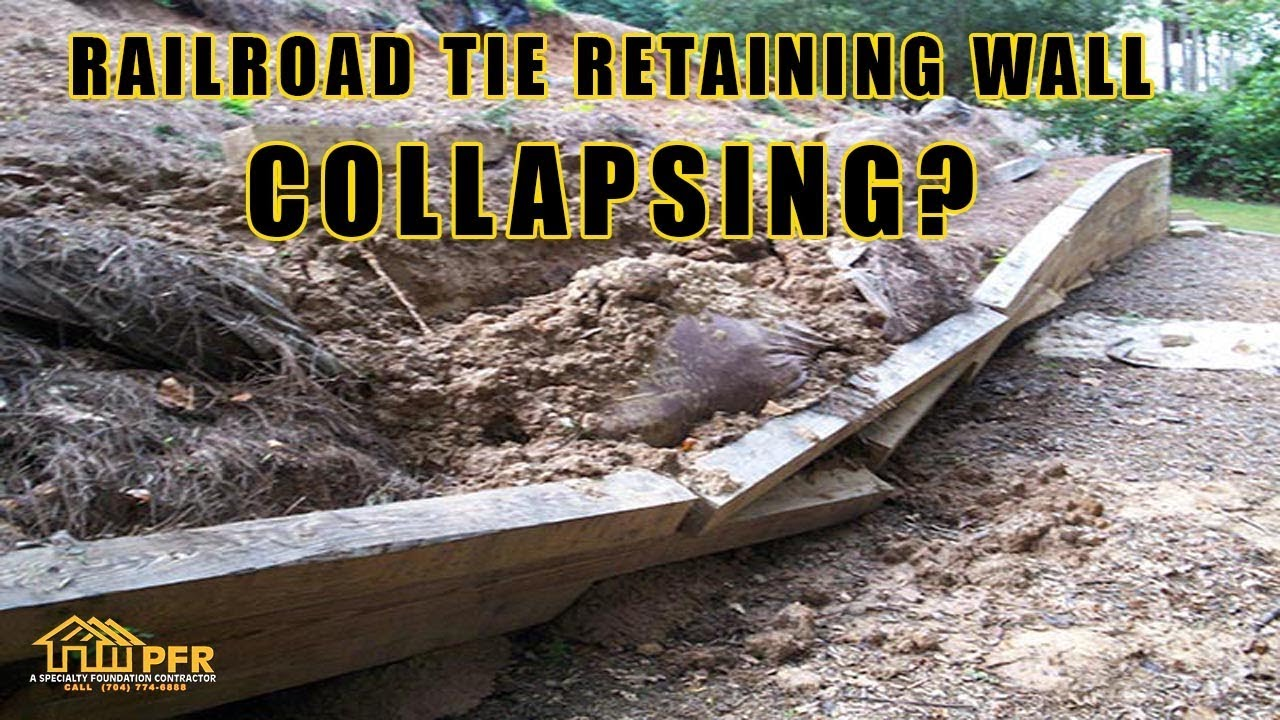 RAILROAD TIE RETAINING WALL COLLAPSING 704 787 6972 CHARLOTTE NC