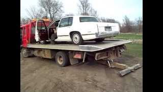 how not to unload a nice cadillac deville off a tow truck wrecker rollback as seen on tv