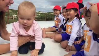 Adorable Japanese children meet cute American baby