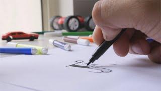Closeup shot of man / boy colouring the alphabet with black sketch pen