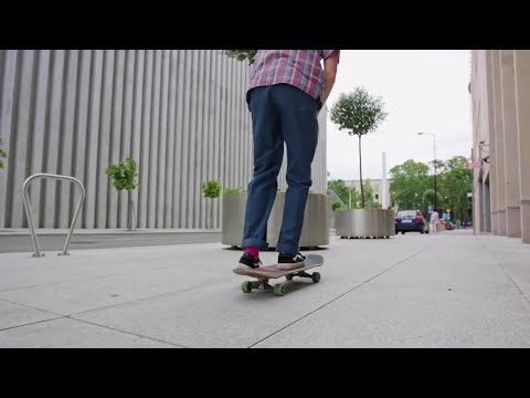 Hipster On A Skateboard Stock Video