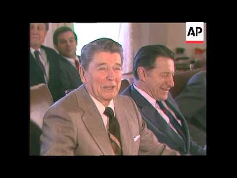President Ronald Reagan answers questions from the press about the Iran-Contra controversy