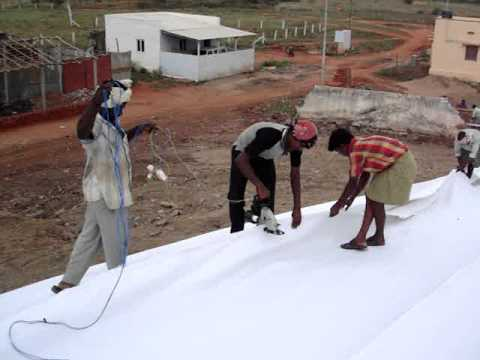Non-Woven Geotextile being Installed using Automated Sticthing Machine at Dumpsite