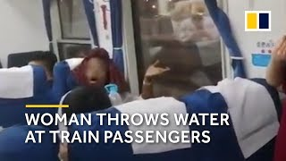 Woman in wrong seat on train throws water at passengers in China