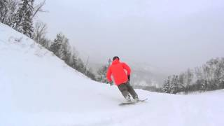 Hardboot carving at Kiroro in flat light and soft snow on Coiler St...