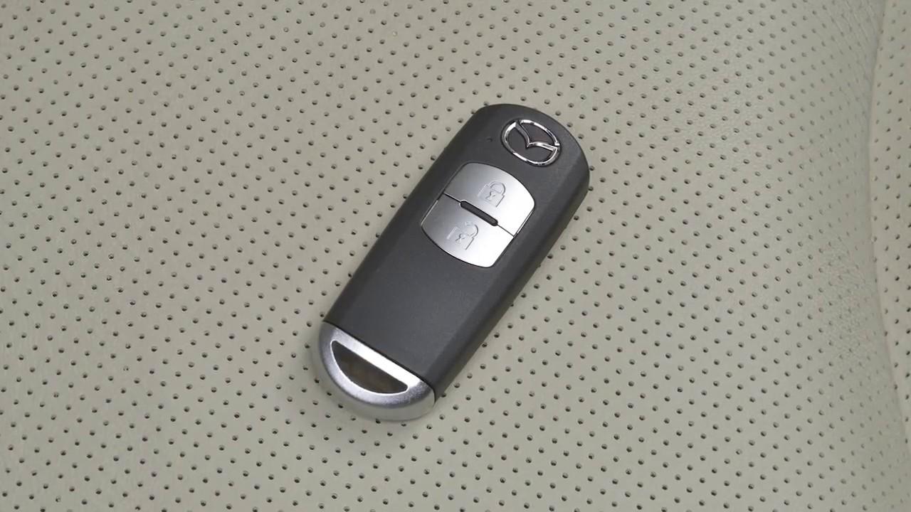 Hoe werkt Smart Keyless entry op de Mazda CX-5?