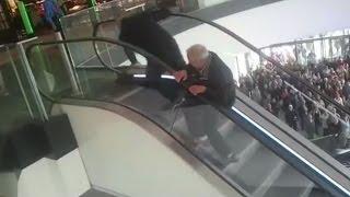 Escalator Fail: Polish Men Fall Upstairs Many Times