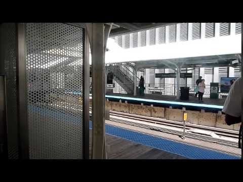 CTA Green Line Train departs while Pink Line Train arrives at Adams/Wabash Station