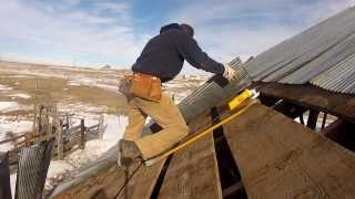 Grinding nails off of a tin barn roof