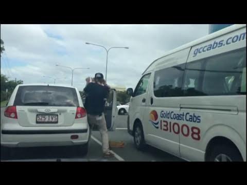 men fighting in the street
