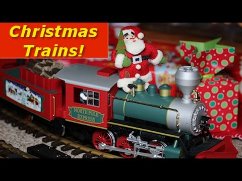 big model trains around the christmas tree and throughout the whole house
