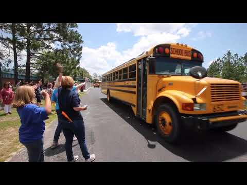 Tommy Smith Elementary School teachers spray silly string and squirt students with water pisto...