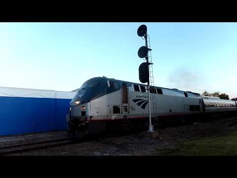 Amtrak Train Ready To Reverse Car Goes Around Gates