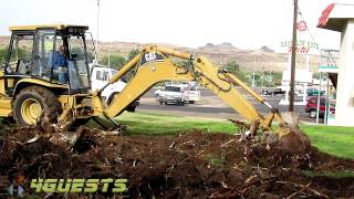 CAT Excavator at Work, Digging up Tree Stumps and Roots