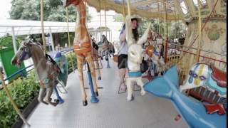 Girl rides on the carousel