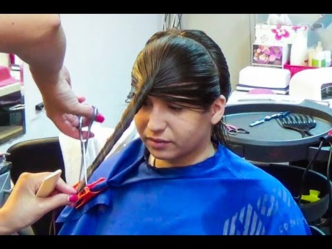 Nice woman getting a new style in long hair, now very layered and with bangs