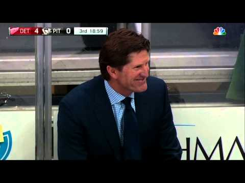 Mike Babcock with a rare moment of levity on the bench