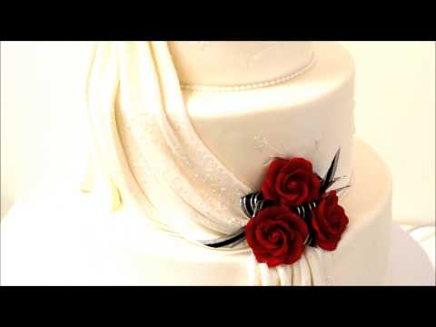 3 tier wedding cake drapes and flowers