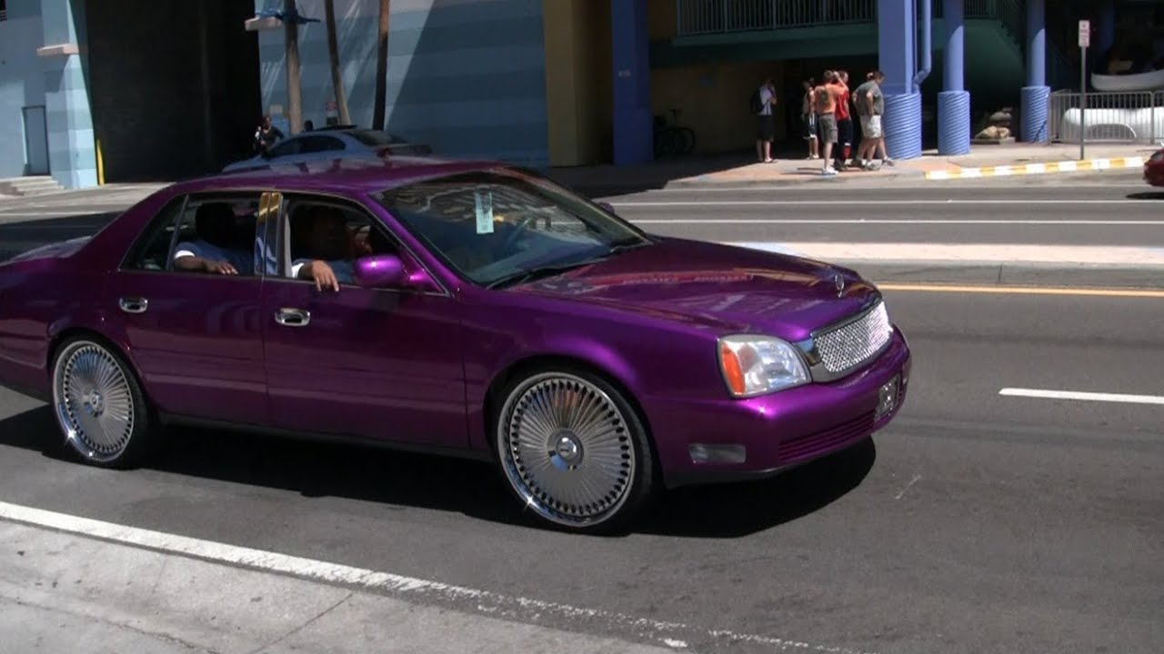 Candy Purple Cadillac on 24 inch DUB Floaters - Spring ...
