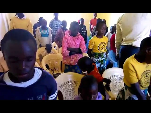 Brother Haron Leading Children in Prayer GMFC / WFF Moi's Bridge Kenya
