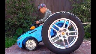 Senya repairing a broken wheel on a car
