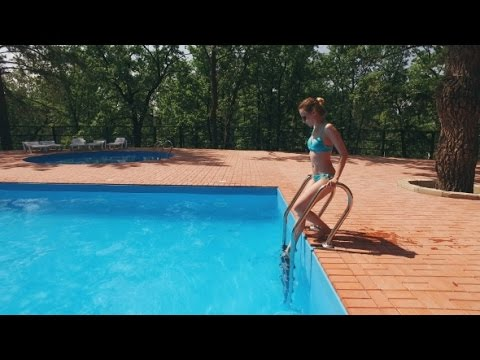 Woman Dressed In Light Blue Swimsuit Is Going Into Pool Outdoor And Swimming | Stock Footage