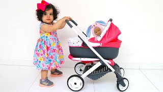 Baby amira and baby in the stroller - ADEL ET SAMI