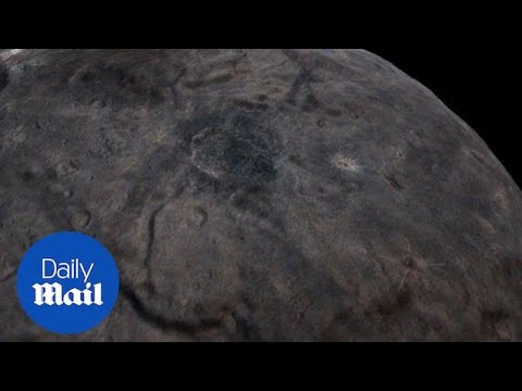 Take A Spectacular Flyover Of Pluto S Largest Moon Charon Daily Mail