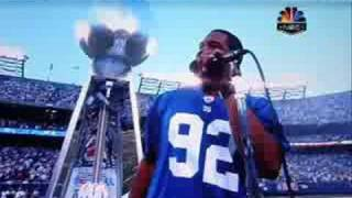 Michael Strahan Pops Out of the Super Bowl Trophy
