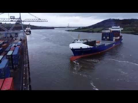 Container ship turning at berth