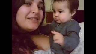 Baby kisses her mother funny