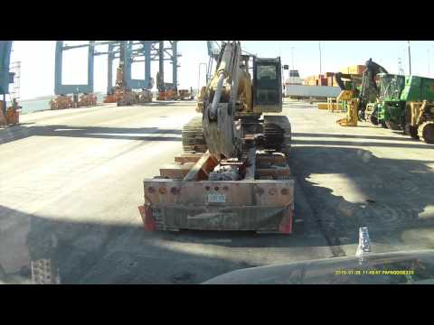 HEAVY HAUL TV: Unloading CAT 330DL Excavator